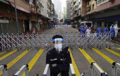 Thousands of Hong Kongers locked down to contain coronavirus